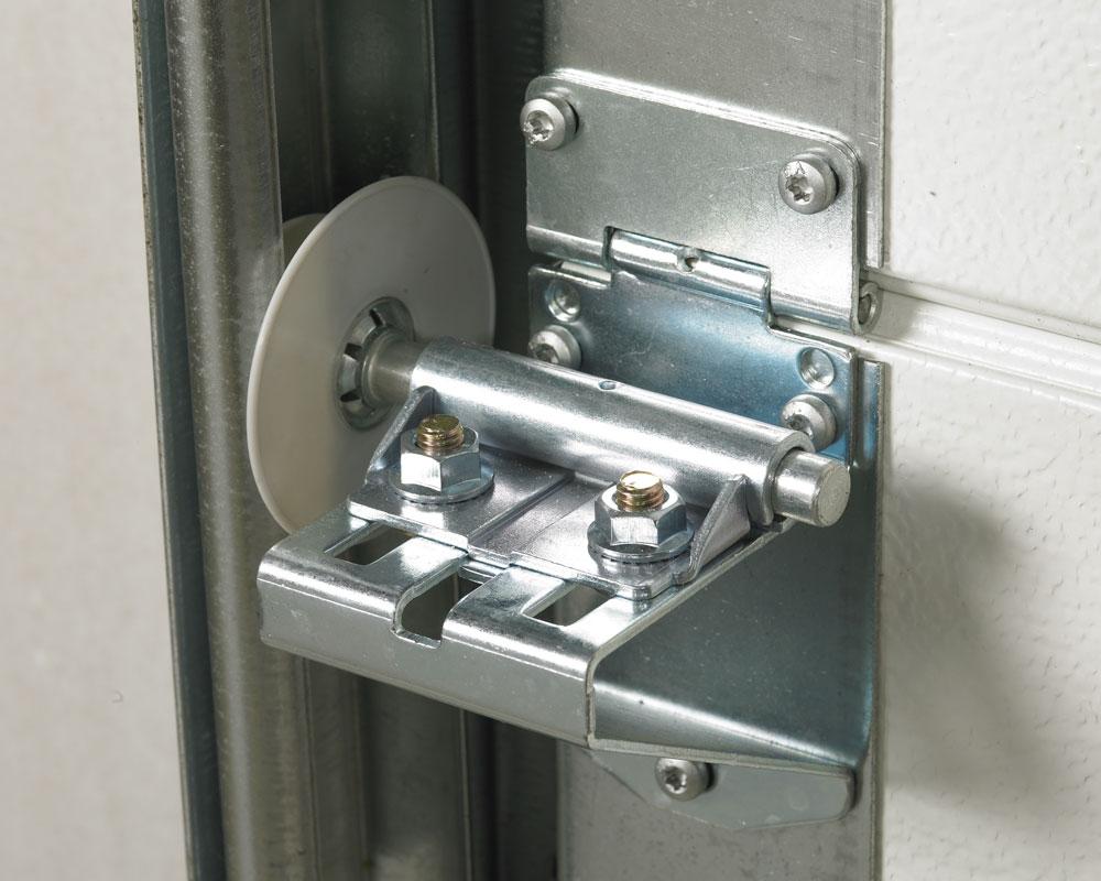 Dispositif de protetion sur les roulettes de porte