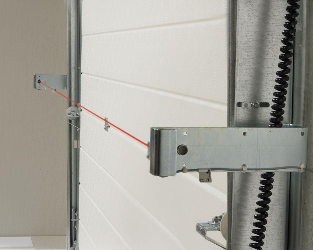 Cellules photoélectriques de sécurité sur les portes à commande électrique